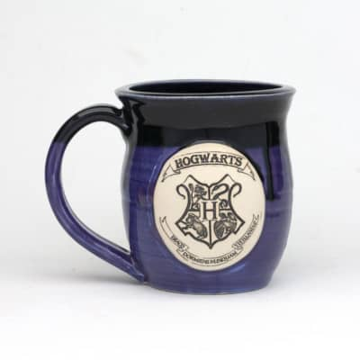 20 oz. hogwarts hocus pocus mug with black glaze dripping over purple glaze. dishwasher safe